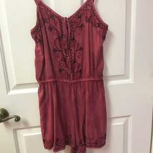 Pink romper. Never worn, ordered wrong size.